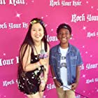 PJ Hubbard being interviewed by Tina Q Nguyen at the Rock Your Hair summer concert event in Hollywood, CA.