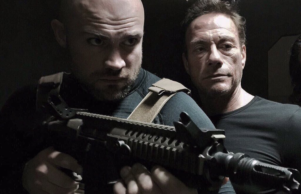 Jean-Claude Van Damme and Cathal Pendred in Black Water (2018)