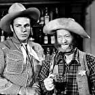 Buster Crabbe and Al St. John in Shadows of Death (1945)