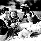 James Stewart, Joan Crawford, Robert Taylor, and Nydia Westman in The Gorgeous Hussy (1936)