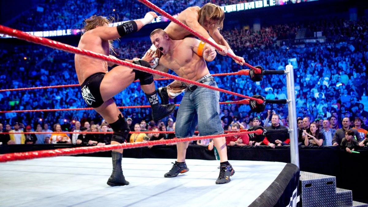 John Cena, seen here getting attacked by Triple H and Shawn Michaels at the 2010 Royal Rumble, holds the WWE record as the shortest 'iron man' in Royal Rumble history.