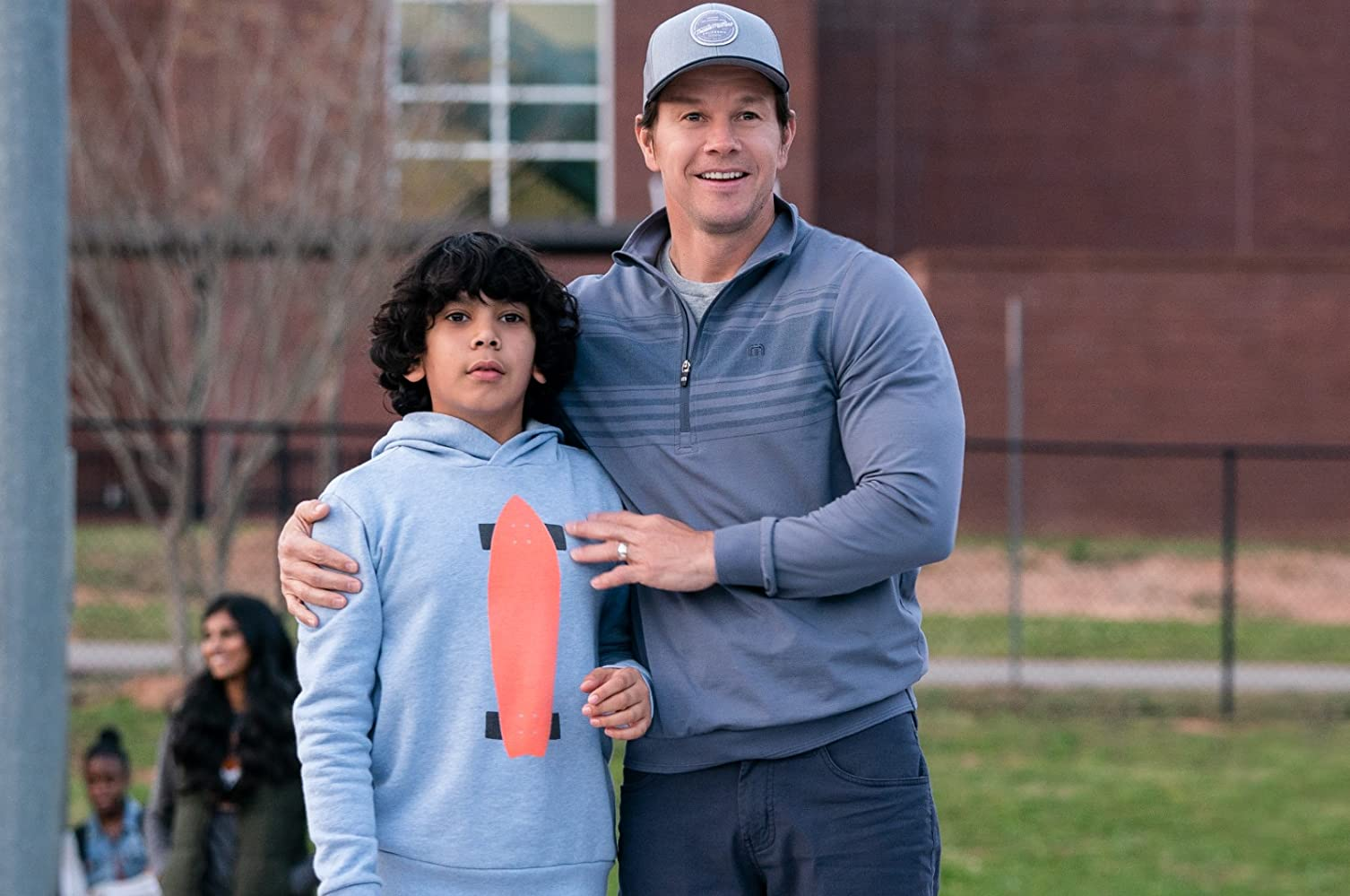 Mark Wahlberg and Gustavo Escobar in Instant Family (2018)