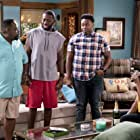 Tichina Arnold, Cedric the Entertainer, Sheaun McKinney, and Marcel Spears in The Neighborhood (2018)