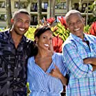 Still of Phil Morris, Candace Smith & Charles Michael Davis on set of 'Same Time, Next Christmas'