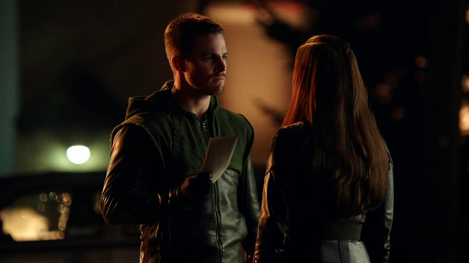 Stephen Amell and Jessica De Gouw in Arrow (2012)