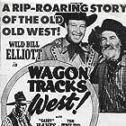 Bill Elliott and George 'Gabby' Hayes in Wagon Tracks West (1943)