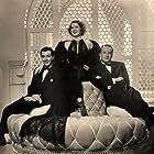 George Sanders, Robert Taylor, and Norma Shearer in Her Cardboard Lover (1942)
