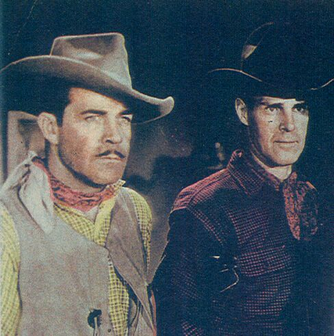 Reed Howes and Kermit Maynard in Brand of the Devil (1944)