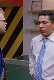 Oscar Nuñez and Adam Conover in Adam Ruins Everything (2015)