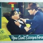 George Brent and Gene Lockhart in You Can't Escape Forever (1942)