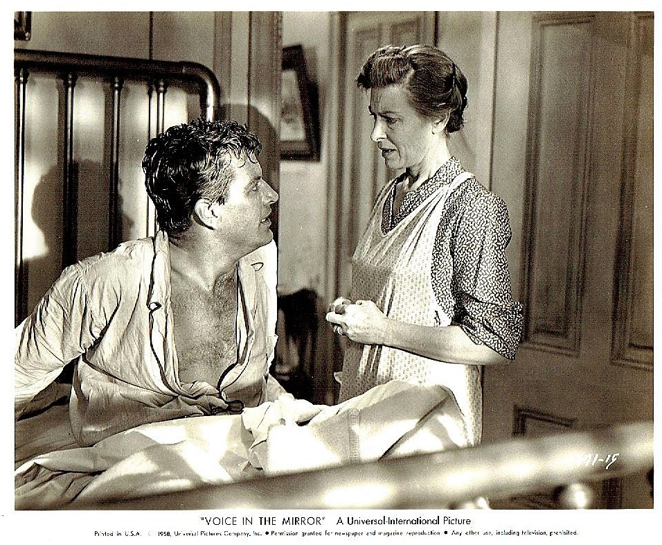 Peggy Converse and Richard Egan in Voice in the Mirror (1958)