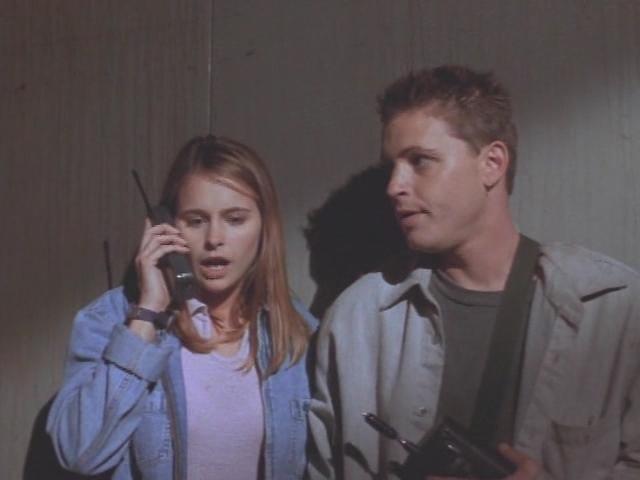 Ami Dolenz and Corey Haim in Demolition University (1997)