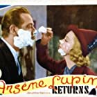 Melvyn Douglas and Virginia Bruce in Arsène Lupin Returns (1938)