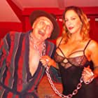 Johnny Mask and Nicole D'Angelo in American Mobster: Retribution (2021)