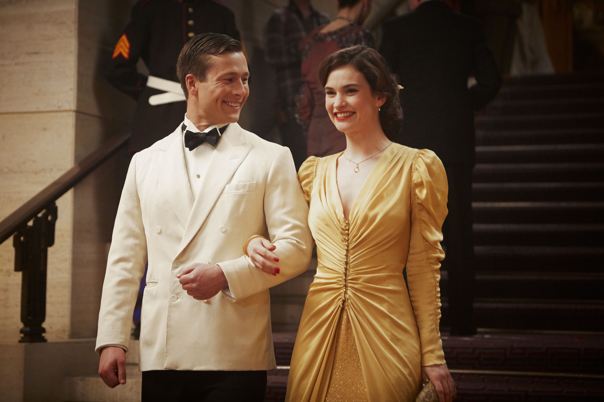 Glen Powell and Lily James in The Guernsey Literary and Potato Peel Pie Society (2018)