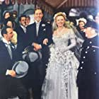 Anna Neagle, Nicholas Phipps, Tom Walls, and Michael Wilding in Maytime in Mayfair (1949)