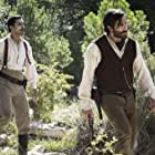 Jake Gyllenhaal and Riz Ahmed in Les frères Sisters (2018)