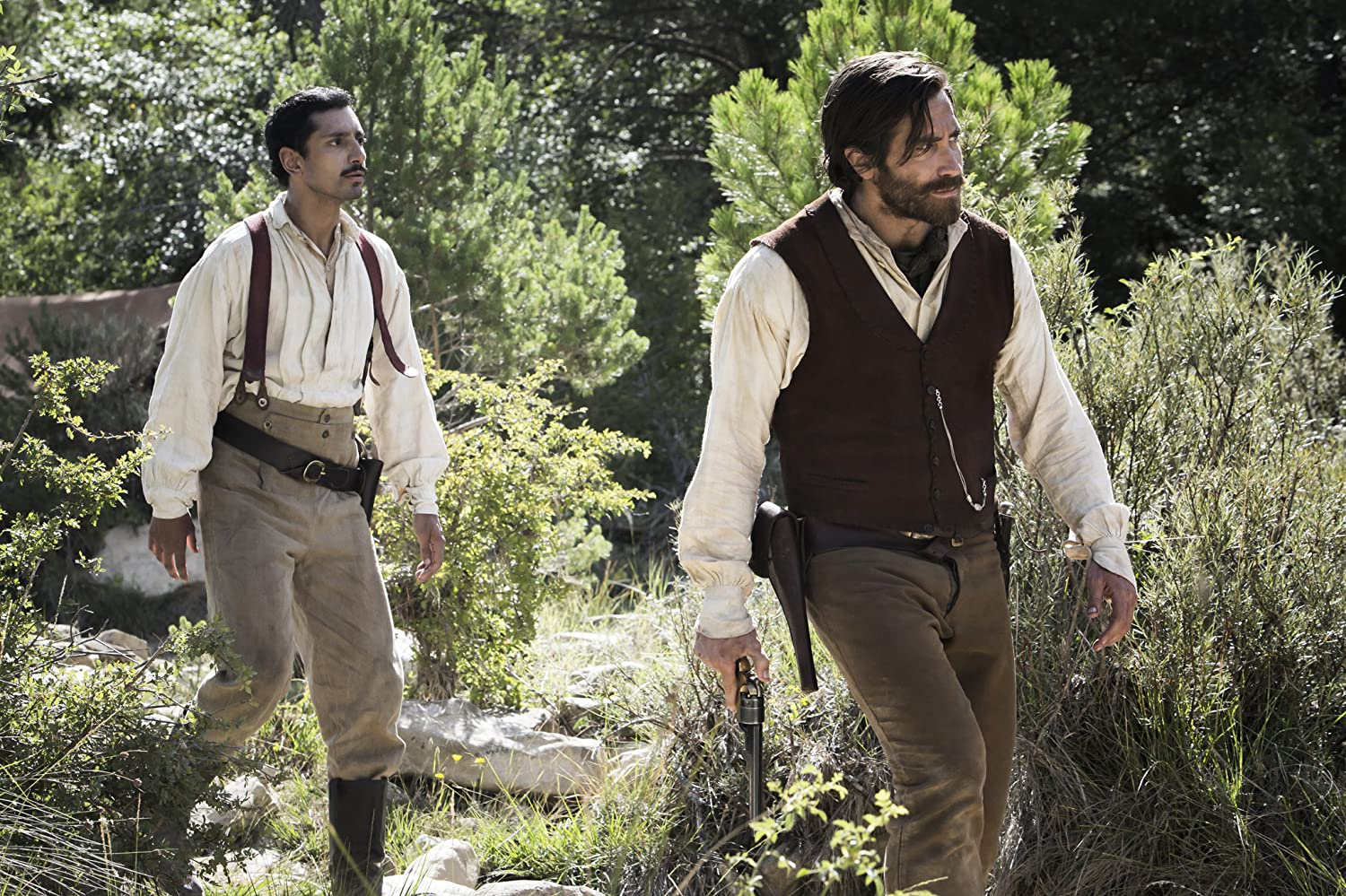Jake Gyllenhaal and Riz Ahmed in The Sisters Brothers (2018)
