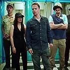 Sam Rockwell, Robin Hellier, Peter Polycarpou, Al Weaver, Ben Schwartz, and Phoebe Fox in Blue Iguana (2018)