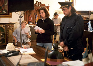 "Lorena David on the set of ""Bravo"" with actor Oscar Casteneda"