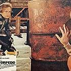 Stéphane Audran and Klaus Kinski in La peau de torpedo (1970)