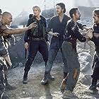 (Left to right):  Van Zan (Matthew McConaughey) (third from left), Alex Jensen (Izabella Scorupco), Creedy (Gerard Butler), Ajay (Alexander Siddig), Quinn (Christian Bale), Gideon (Terence Maynard).