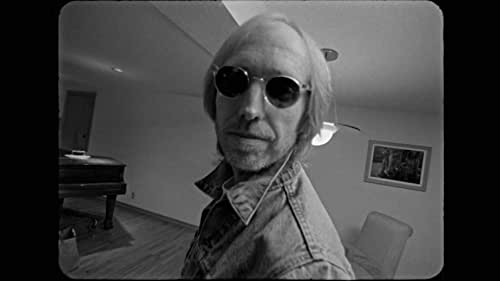 Drawn from an archive of 16mm film, Tom Petty works on his 1994 album Wildflowers.