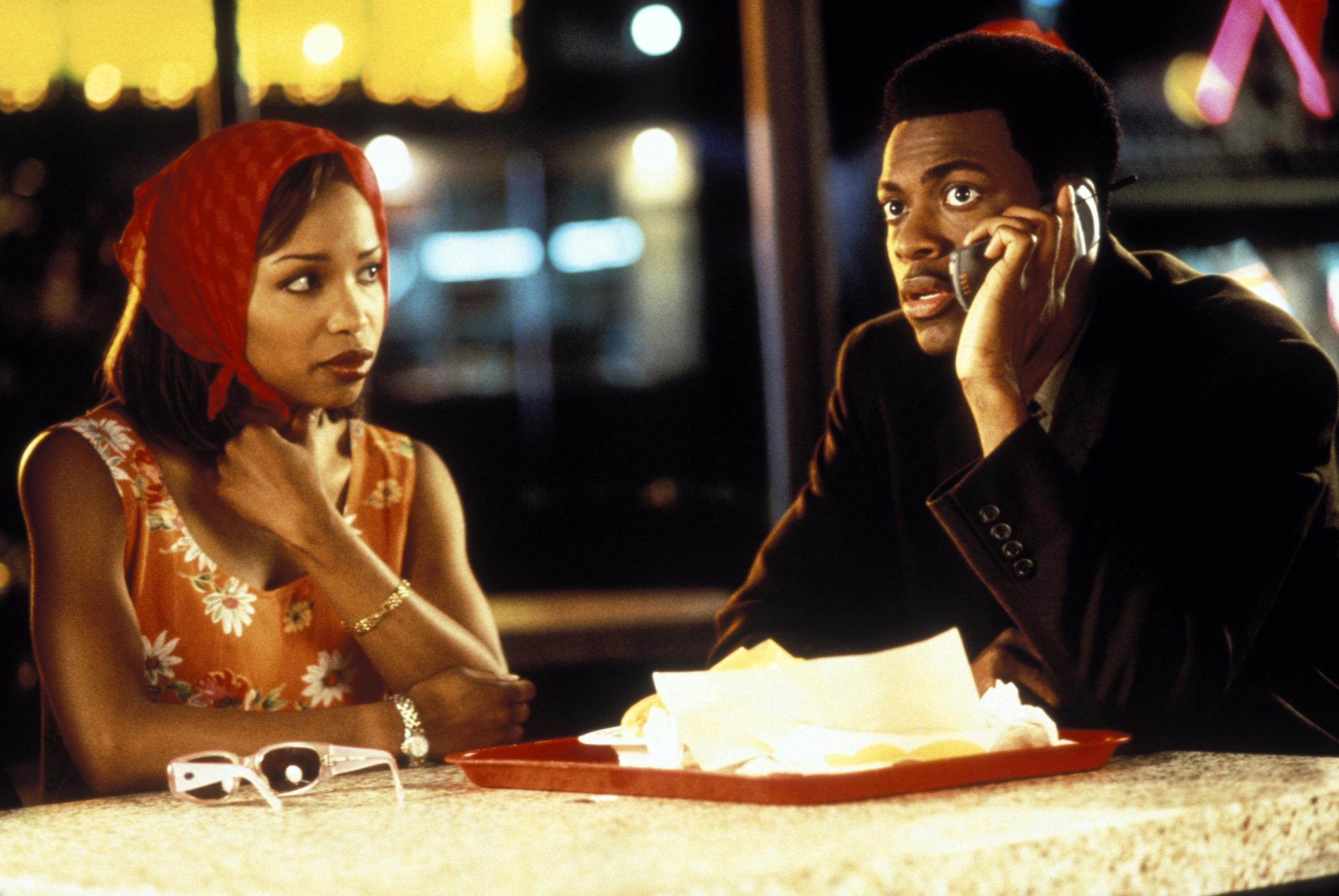 Chris Tucker and Elise Neal in Money Talks (1997)