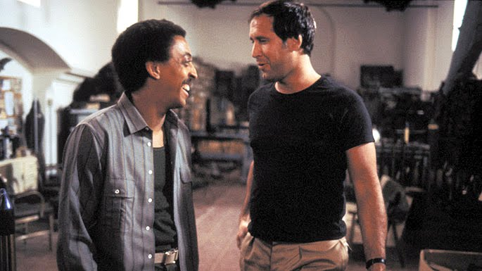 Chevy Chase and Gregory Hines in Deal of the Century (1983)