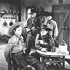 Don 'Red' Barry, Augie Gomez, Bob Kortman, and Al Taylor in Adventures of Red Ryder (1940)