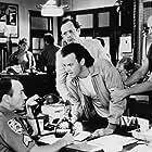 Michael Keaton, Christopher Lloyd, Peter Boyle, and Brad Sullivan in The Dream Team (1989)