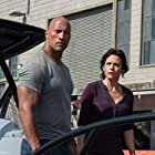 Carla Gugino and Dwayne Johnson in San Andreas (2015)