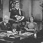 Sammy Baugh, Neil Hamilton, Pauline Moore, and Charles Trowbridge in King of the Texas Rangers (1941)