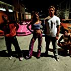 Paul Walker, Amaury Nolasco, Michael Ealy, and Devon Aoki in 2 Fast 2 Furious (2003)
