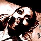 Raine Brown in 100 Tears (2007)