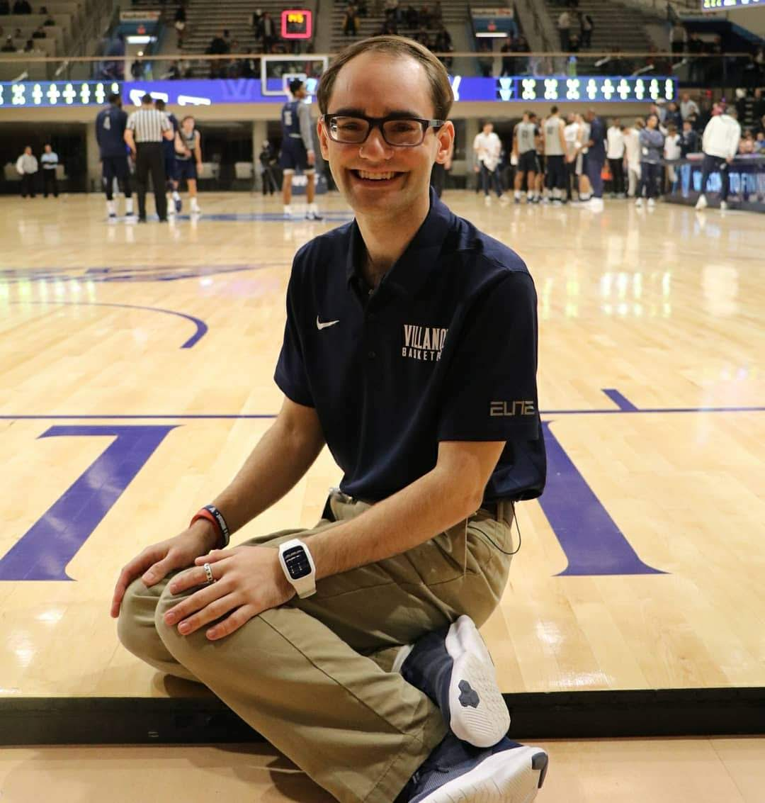 Andrew McKeough sits on the court of the Finneran Pavilion at Villanova University in October of 2018