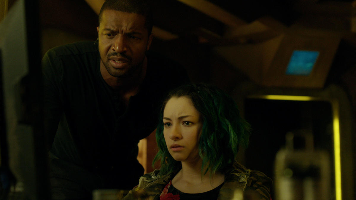 Roger Cross and Jodelle Ferland in Dark Matter 2015