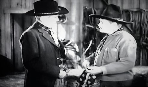 Henry Hall and Jack Rockwell in Pirates on Horseback (1941)