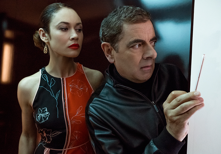 Rowan Atkinson and Olga Kurylenko in Johnny English Strikes Again (2018)