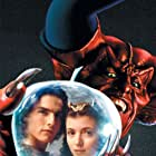Tom Cruise, Mia Sara, and Tim Curry in Legend (1985)