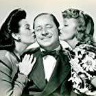 Robert Benchley, Virginia Bruce, and Rosalind Russell in Hired Wife (1940)
