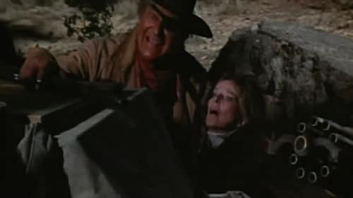 Marshal Rooster Cogburn unwillingly teams up with Eula Goodnight to track down her father's murderers.