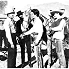 Randolph Scott, Craig Stevens, L.Q. Jones, Manuel Rojas, and Peter Whitney in Buchanan Rides Alone (1958)