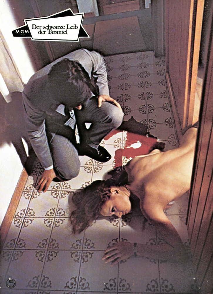 Barbara Bach and Giancarlo Giannini in La tarantola dal ventre nero (1971)