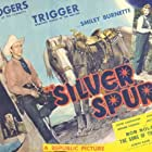 Roy Rogers, Phyllis Brooks, Smiley Burnette, and Trigger in Silver Spurs (1943)