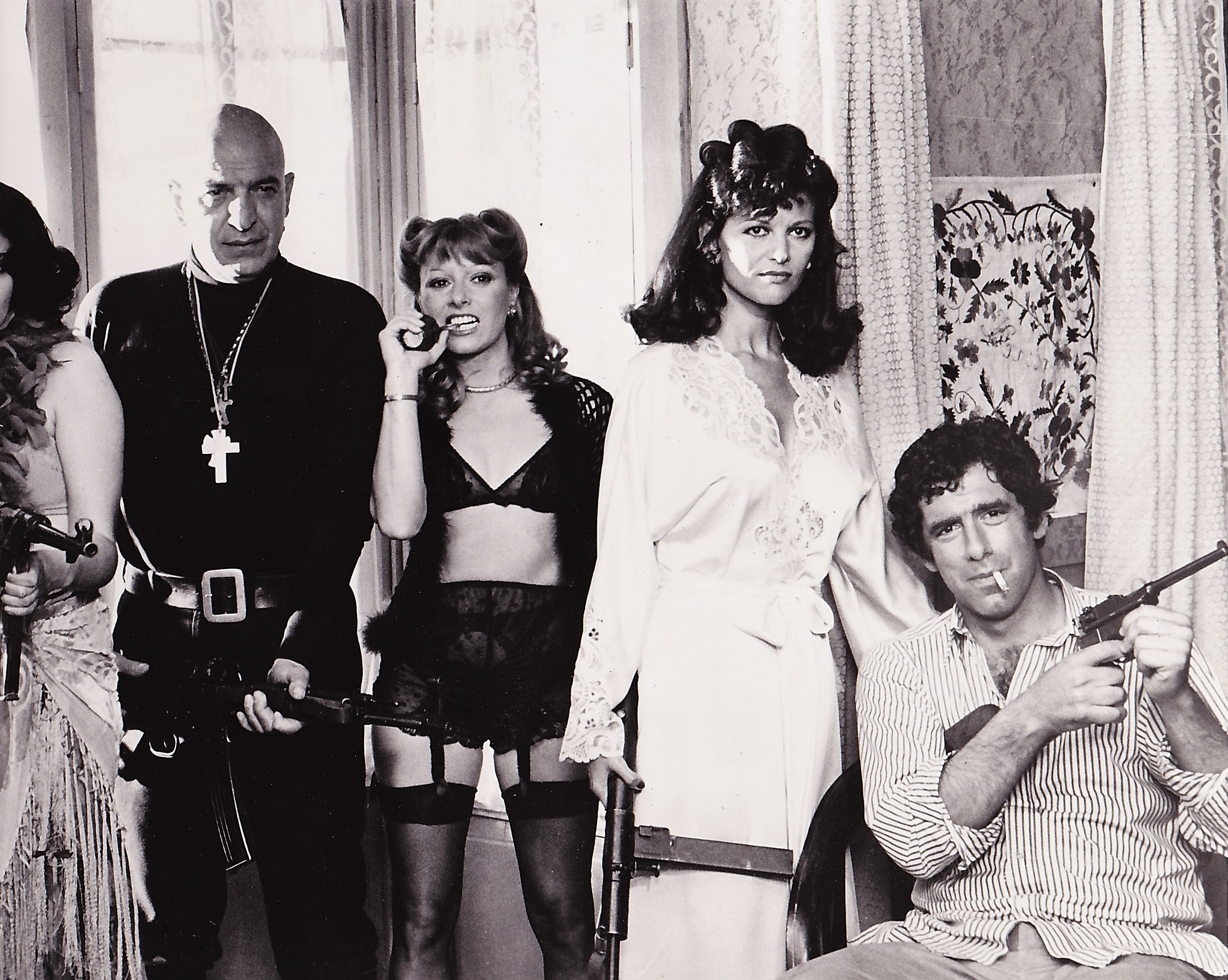 Claudia Cardinale, Elliott Gould, Telly Savalas, and Vanna Reville in Escape to Athena (1979)