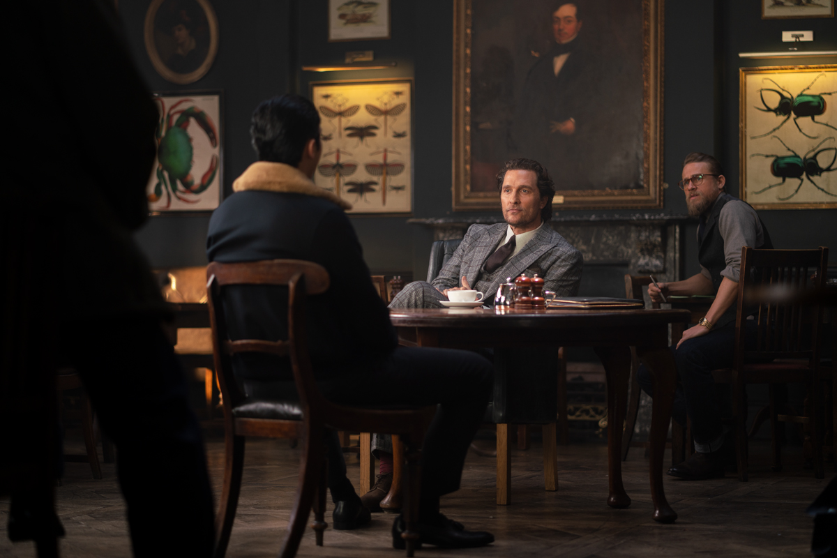 Matthew McConaughey, Charlie Hunnam, Jason Wong, and Henry Golding in The Gentlemen (2019)