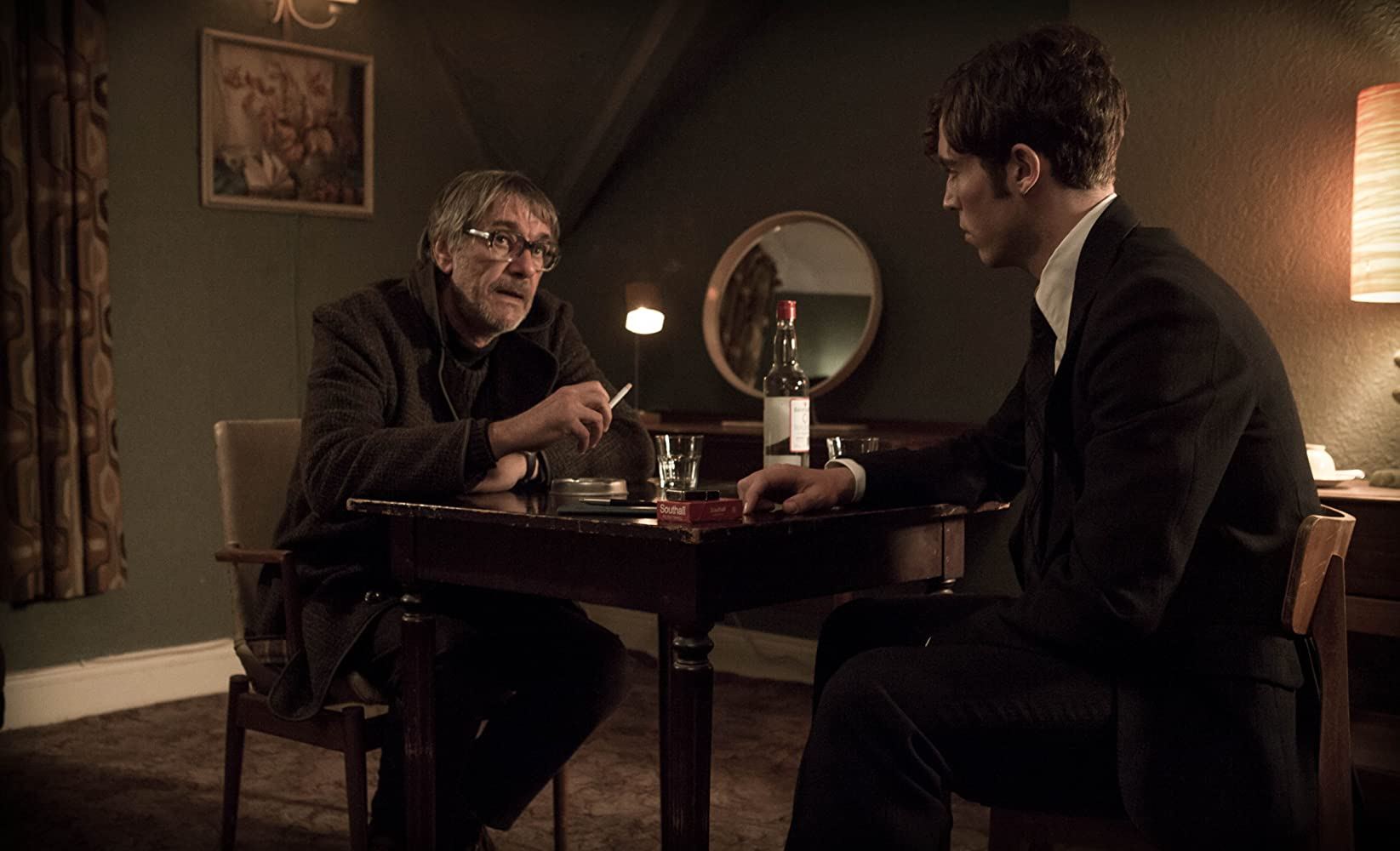 Marcel Iures and Tom Hughes in The Game (2014)