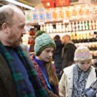 Louis C.K., Ursula Parker, and Hadley Delany in Louie (2010)