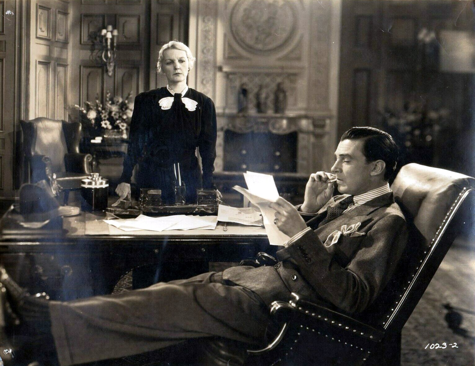 Naomi Childers and Walter Pidgeon in Man-Proof (1938)
